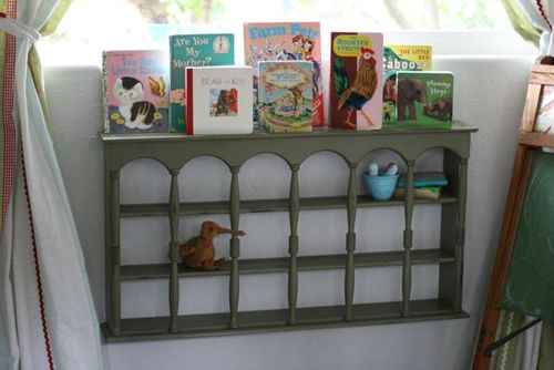 Playroom with wall hanging with books -8