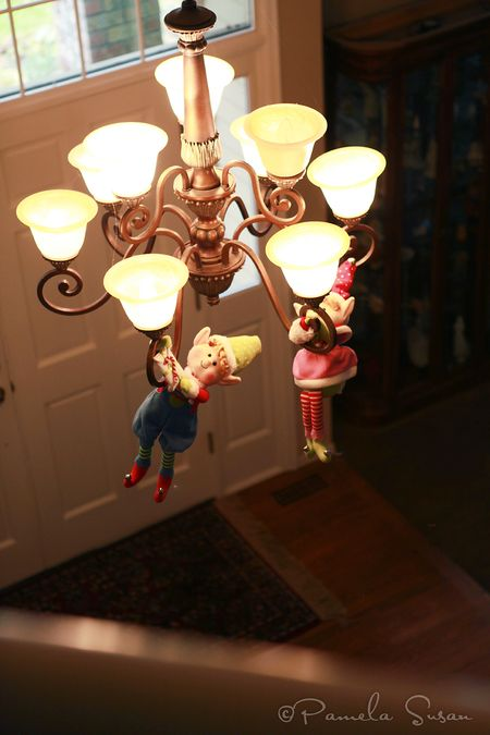 Elf-on-shelf-hanging-from-chandelier