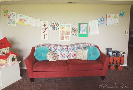 Playroom-red-couch-vintage-quilt-art-wall-7